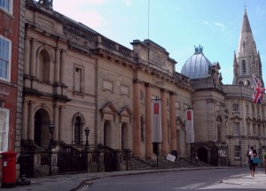 A view of the Galleries of Justice in Nottingham's Lace Market, with the old Unitarian Chapel, currently the Pitcher & Piano, in the background on the right.